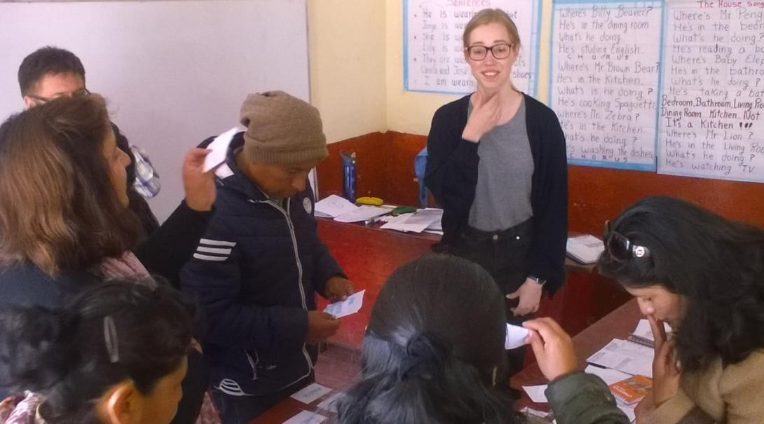 Local teachers receive assistance with their English pronunciation from a volunteer on her Global Gap Year abroad in Peru.